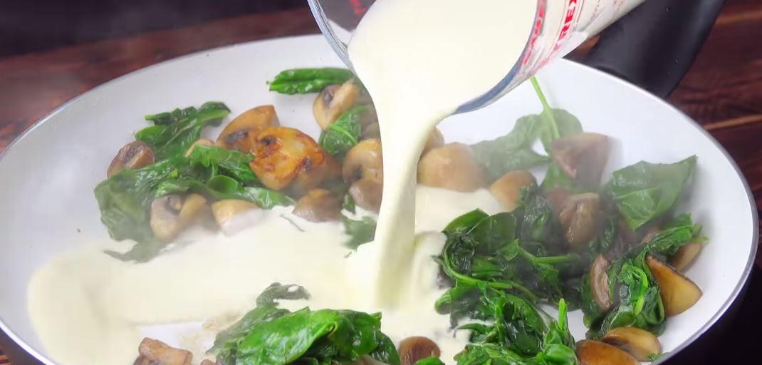 Filet de boeuf sur sauce au champignons, épinards, parmesan et pommes duchesses